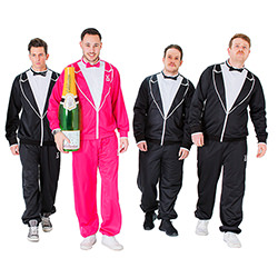 Four male models wearing traxedos, three wearing black and one wearing pink carrying a large champagne bottle