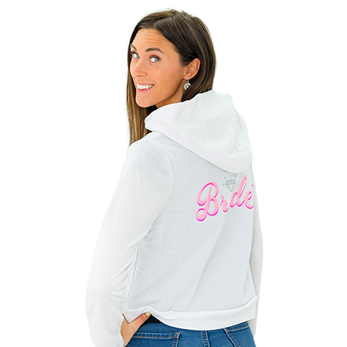 A woman wearing a Bride-to-Be hoodie
