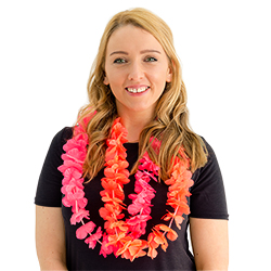A girl wearing two Hawaiian leis