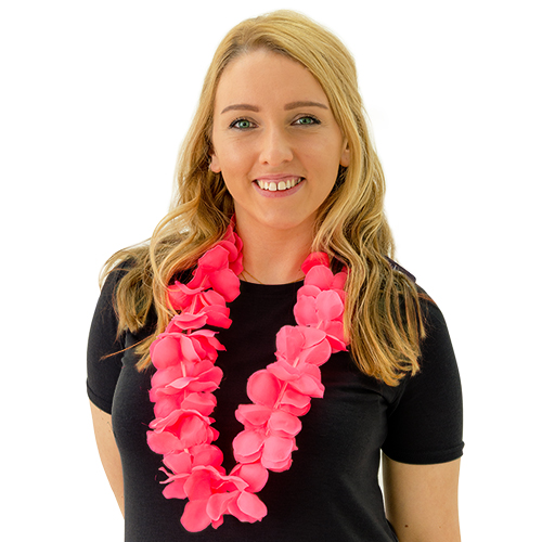 A girl wearing a pink hen party lei
