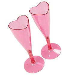 Two heart shaped champagne flutes taken from above