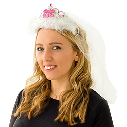 A girl wearing a Bride to Be tiara with the veil over her head