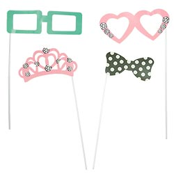 Two pairs of glasses, a tiara and a bow tie on sticks