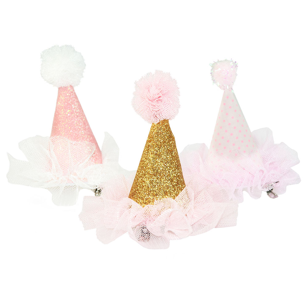 Three mini party hats with the gold one in the foreground
