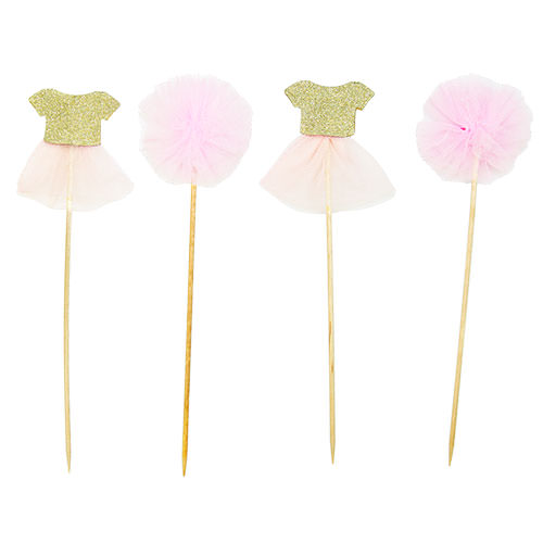 Two tutu cake toppers and two pom poms