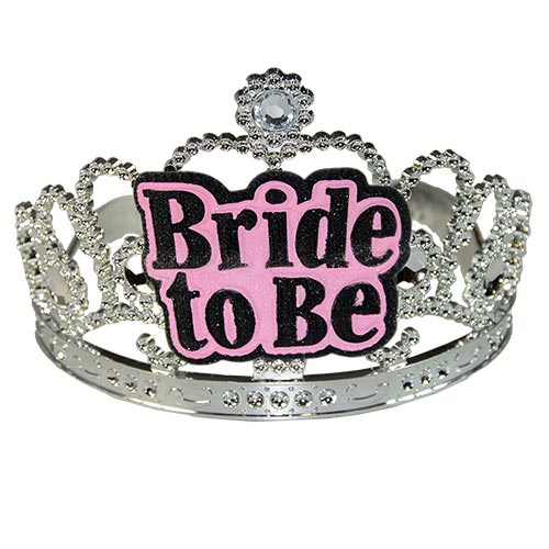 Silver tiara with a pink and black Bride-to-Be badge stuck on front