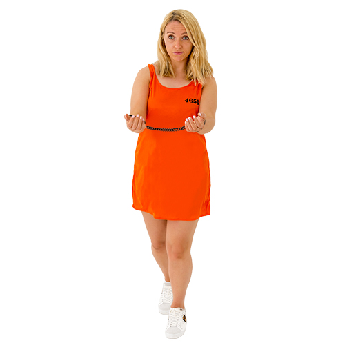 A girl wearing an orange prisoner dress with handcuffs on