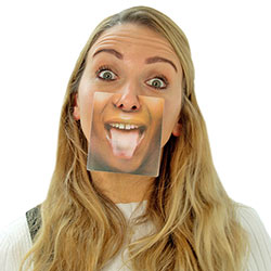 A girl with a face mat attached to her nose, with its tongue sticking out