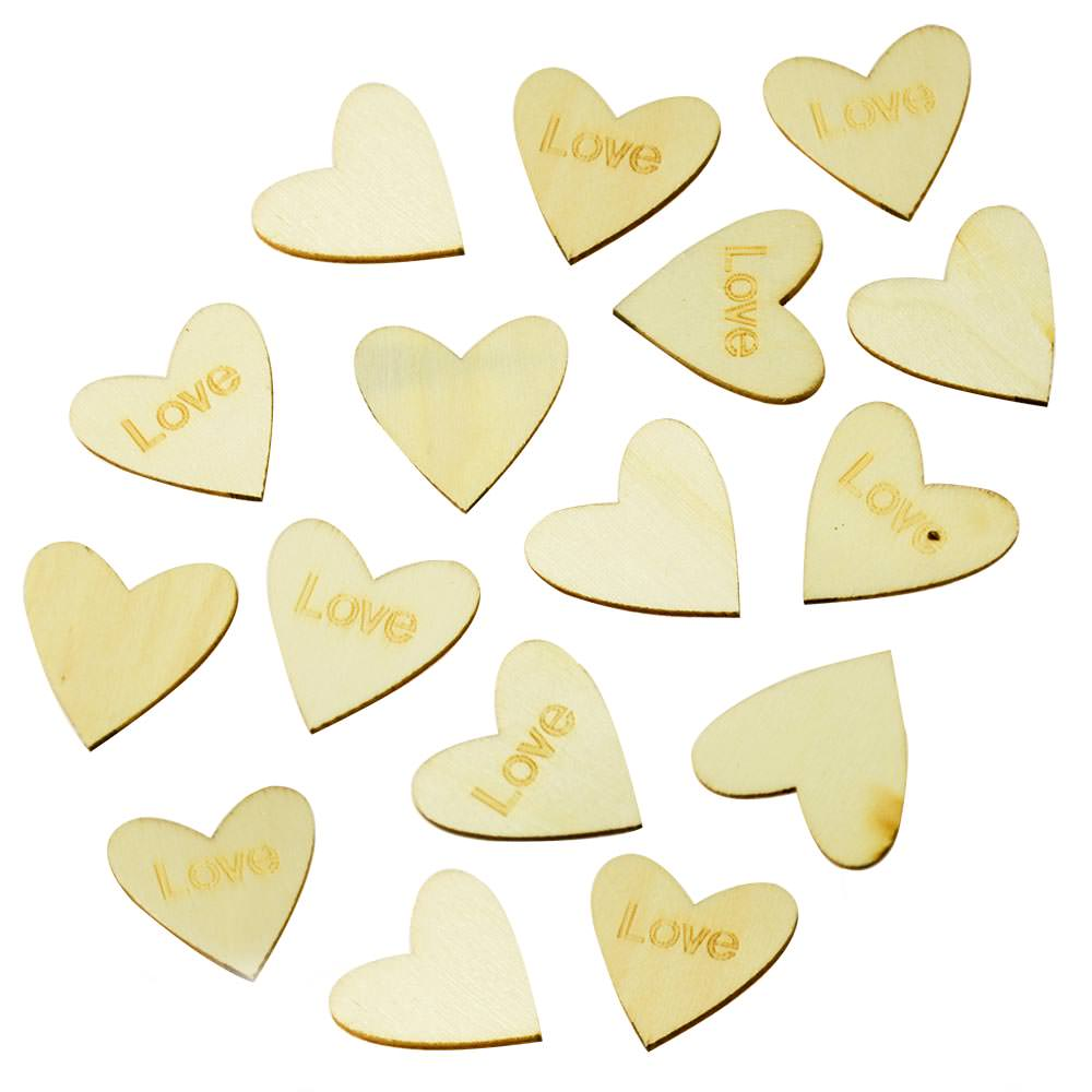 Heart shaped wooden table confetti against a white background