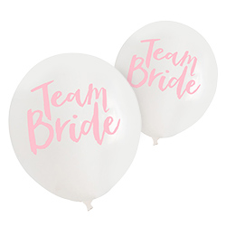 White balloons with team bride written in pink.