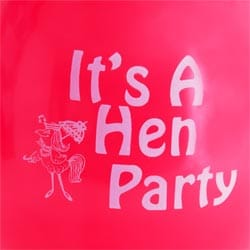 A close up photo of the 'it's a hen party' design on a red balloon