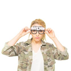 A girl wearing some hen party glasses labelled hen