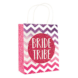 A purple and pink Bride Tribe bag standing up