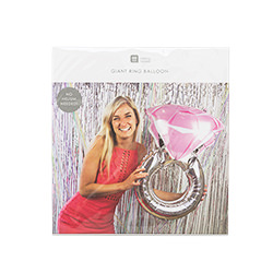 The pink and silver wedding ring balloon in its packaging