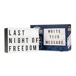 The light box with Last Night of Freedom written on and the box next to it