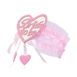 Bride to Be pink heart on a garter taken from the side