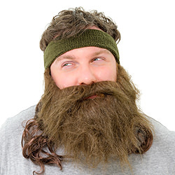 A man looking angry wearing a fake beard and mullet attached to a headband