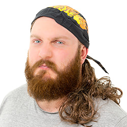 A man looking angry, wearing a Hell's Angel mullet with bandana