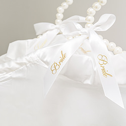 The ribbon has bride written on it in gold writing