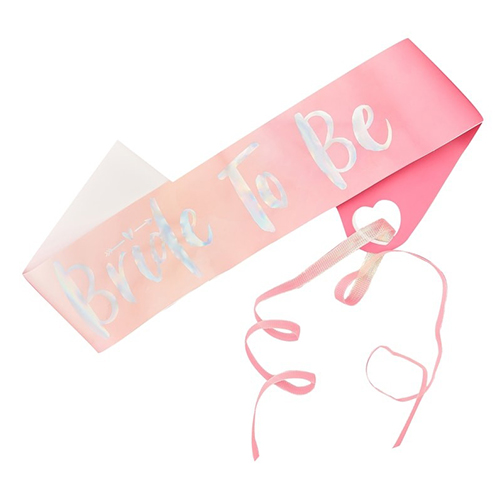 Bright pink bride to be sash with silver foil text.