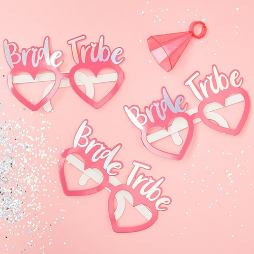 Bride tribe glasses against a pink background