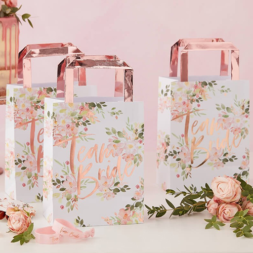 A pack of five floral team bride gifts bags.