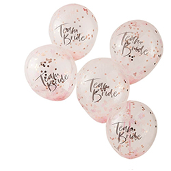 Five team bride balloons with rose gold confetti.
