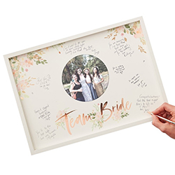 Floral team bride frame with messages being written.