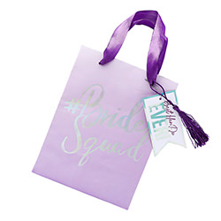 A purple bride squad gift bag.