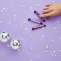 Lifestyle image including mirror balls and Parma Violets.