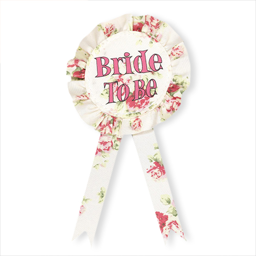 Floral bride to be rosette with hot pink writing.