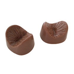 Two of the edible chocolate anus on their own.