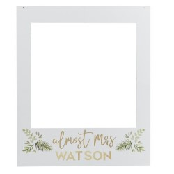 The frame with Almost Mrs Watson written on the front.