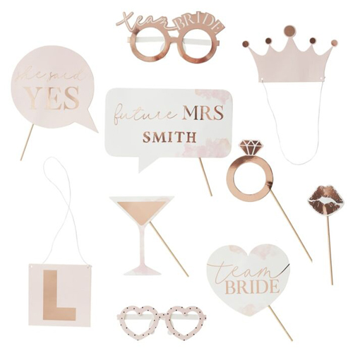 Rose gold photo booth props on a white background.