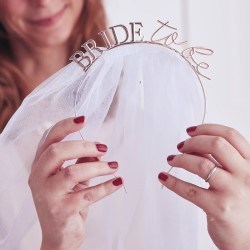 A close up of the bride to be writing.