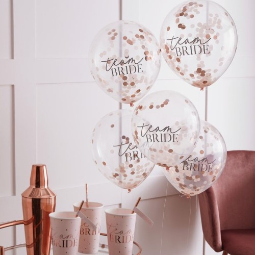 Five confetti balloons seen with matching cups.