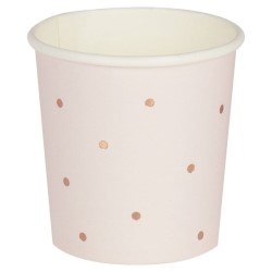 Pink polka dot shot cups seen on a white background.