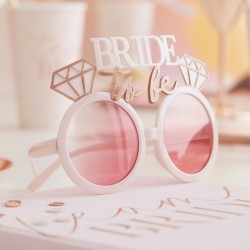 The glasses on a table with other hen party items.