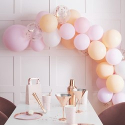 The balloon arch with a table set beneath it.