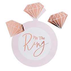 The pin the ring game with three rose gold diamonds.