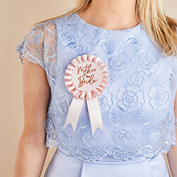The rosette on a girl in a blue dress.
