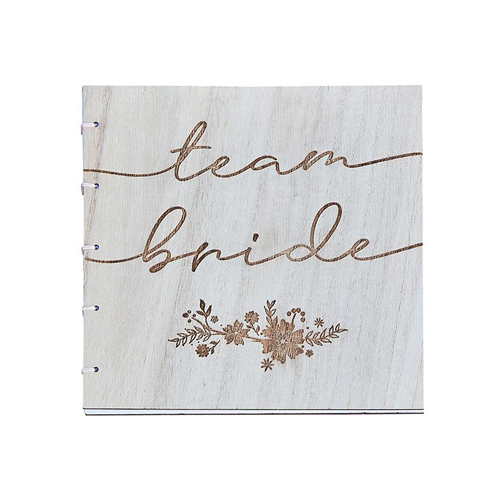 The wooden team bride guest book on a white background.