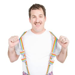 A man wearing rainbow braces, with four shots in