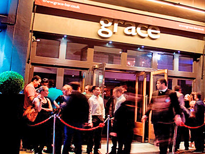 People lined up outside of Grace Bar and Restaurant, London