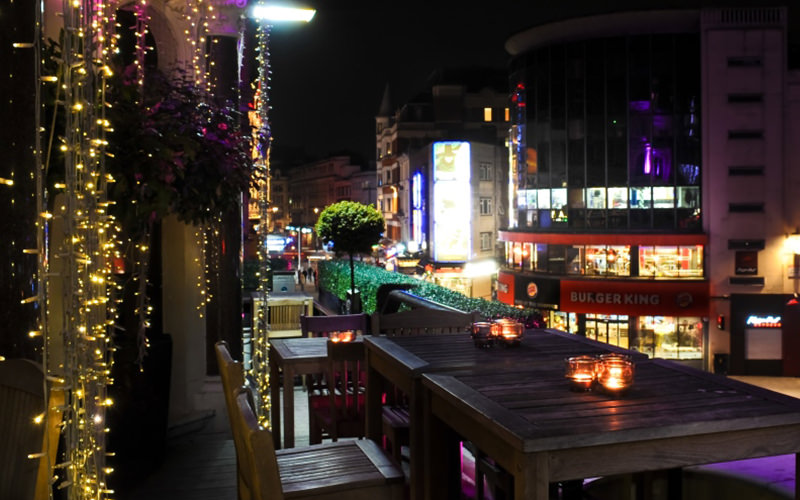 A wooden table on the outdoor terrace at Ruby Blue, London