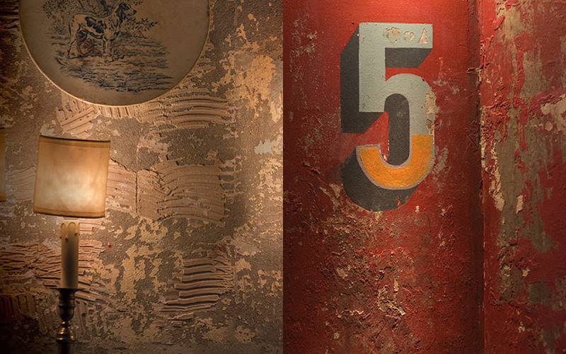 A number five on a red wall