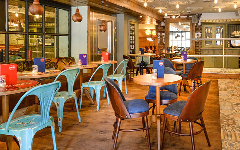 Tables and blue chairs at Core Bar, London