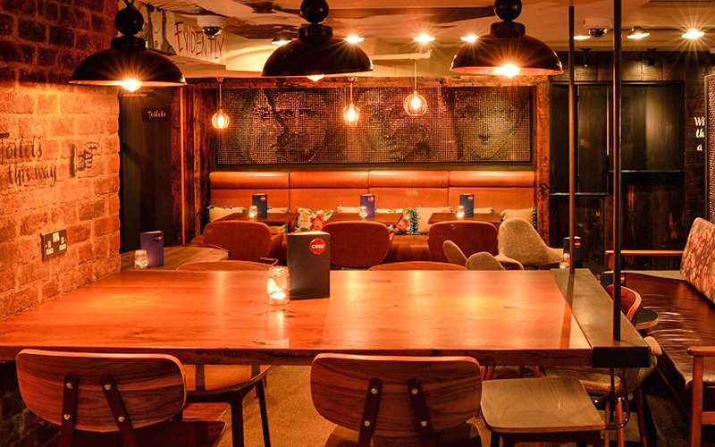 A large table with lights on the top, with a table in the background, at Core, London