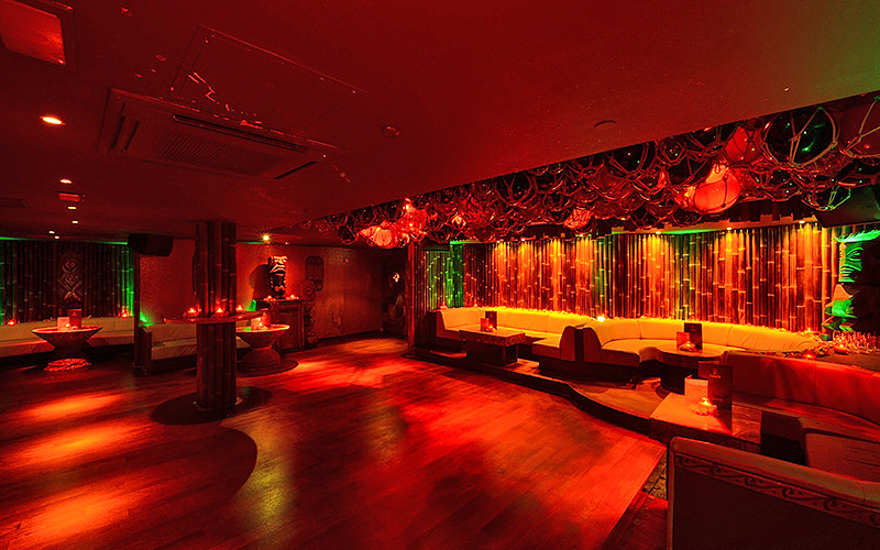 An empty room with booths along the walls at Kanaloa Club, London