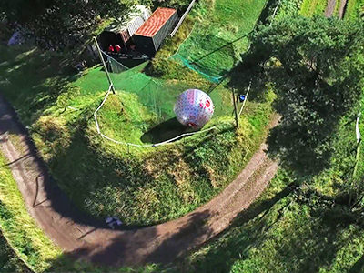 A birds eye view of the bottom of a track where a zorb has rolled down